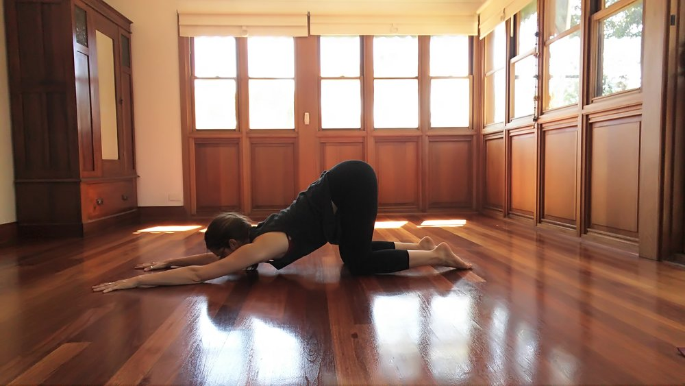 Stack the hips on top of the knees. Let your arms reach forward as you guide your heart towards the ground.
