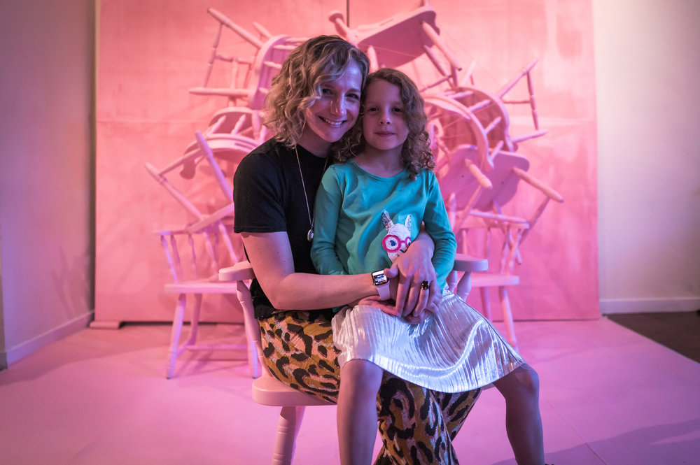"""Phenomenal Women in Philly panelist Ashley Primis poses with her daughter in front of """"The Illusion of Scarcity"""" art installation.  via @al.turay"""