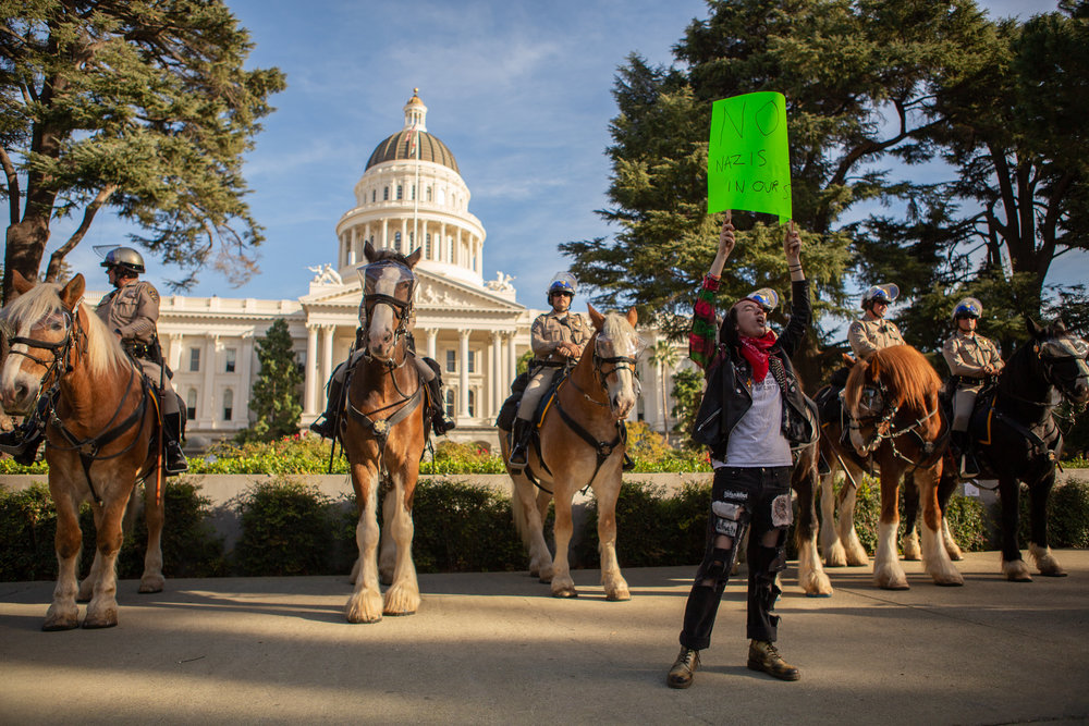 California conservatives assembled outside the steps of the state Capitol at 1pm in Sacramento, CA on November 4th to drum up support leading up to the November midterm elections. The demonstration had the required permits and remained largely fenced off and guarded by local law enforcement. Mounted units used for crowd control and police on bicycles separated the rally from counter demonstrations along 10th street with minimal arrests throughout the day.