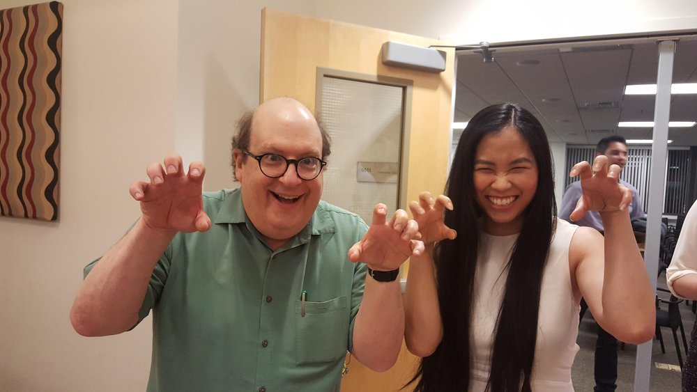 "How I spend my Friday nights - Geeking out with Jared Spool! He suggested several poses, one of which was the ""tiger claw"" pose. In all my experience with photography, I had yet to see anyone pull that one out of the bag so I I knew we just had to try it!"
