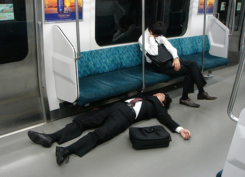 Exhausted workers in Tokyo