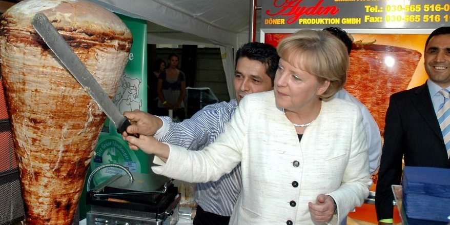 Angela Merkel preparing a Doner Kebab in Berlin
