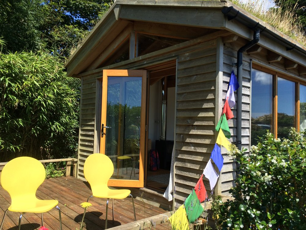 Cornwall Airbnb featuring cute colourful flags! Taken by Justine Cross for  Wanderer of the World .