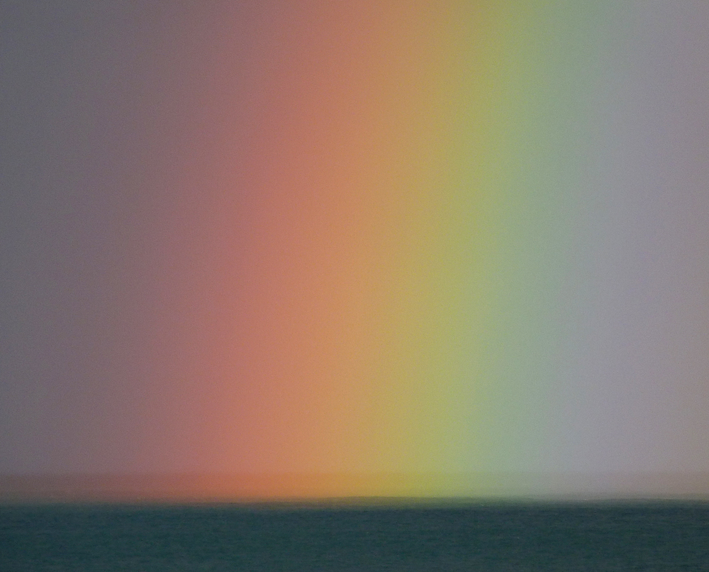 The end of the rainbow during a storm, off Rousse.