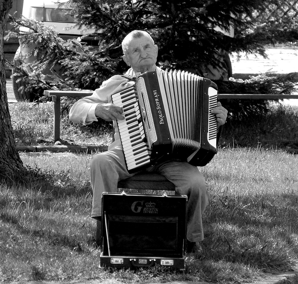 The world's saddest man plays the accordian.