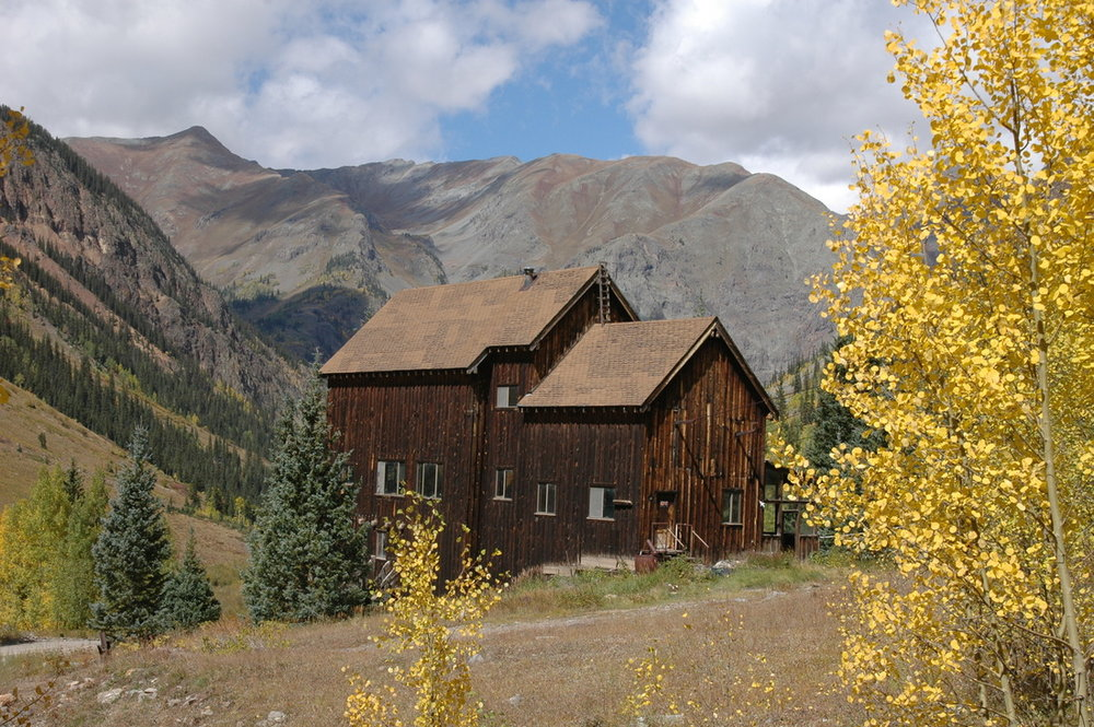 "This is truly a unique offering located just about 5 miles from Silverton up Cunningham Creek from Howardsville. The property is comprised of 2 mining claims; Townsite and Niegold Townsite that parallel one another. The old Buffalo Boy Lower Tramhouse is included on the Niegold Townsite claim. A lot of history here. The Niegold brothers from Germany staked the claims at the turn of the century and developed a small community with homes, cabins, general store, inn, etc. The Buffalo Boy Mine is located high above timberline and the ore was transported by tram to this lower tramhouse where it was transferred and transported to the mill. The tramhouses and cable system were built circa 1929 and a portion of the lower tramhouse was improved into living quarters in the 1970's. The property would lend itself well to being developed into a destination retreat lodge and cabins. The large, substantial post and beam structure is in excellent condition and would serve as a solid framework upon which to improve the building into habitable space to function  as a lodge. The structure was built to last and withstand the dynamics of supporting the cables and heavy weight load of ore being transported down from the mountain top mine. The old Stony Pass Road which was utilized as the main roadway from Del Norte over the Continental Divide to Silverton runs through the property. This location is a gateway to high mountain recreation and would provide for an excellent ""base camp"" for high country activities i.e. high altitude training (situated at an elevation of approximately 10,000 ft), back country skiing and hiking, 4WD and bicycle/motorcycle touring or simply getting away from it all in a spectacular Rocky Mountain setting."
