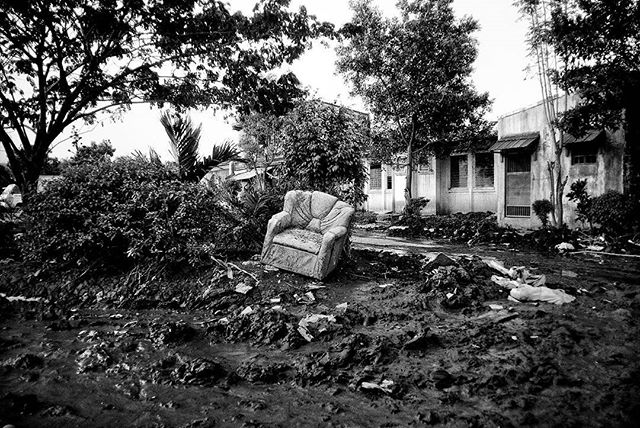 Dislodged furniture lay around inside a gated community in Rizal in Metro Manila, Philippines.  The change in earth's temperature is predicted to cause stronger typhoons like Haiyan. Every year, as more people face these issues, SIGNOS illustrates the new norm, a dark sign of things to come. Climate change does not happen in isolation. The signs are clear and there's no denying what the future generations will be facing.  An outtake from forthcoming book Signos by Veejay Villafranca published by MAPA Books.  @vjvillafranca is taking over @invisphotogasia this week ! Do check it out!  #signos #veejayvillafranca #mapabooks #everydayphilippines #yolandaph #haiyanph  #everydayclimatechange #everydayeverywhere #visayas #philippines #climatechange #climatechangeisreal #photobooks #photobookjousting
