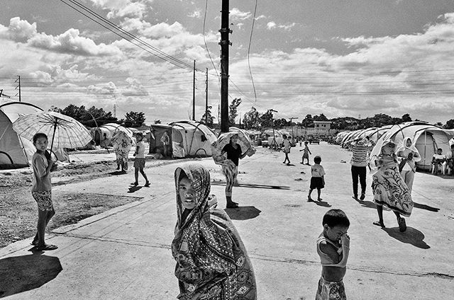 "Families that have been displaced for several months due to stagnant floodwaters from prolonged monsoon rains in 2012, seek temporary shelter in a rundown cola factory in Laguna, Philippines  The change in earth's temperature is predicted to cause stronger typhoons like Haiyan. Every year, as more people face these issues, SIGNOS illustrates the new norm, a dark sign of things to come. Climate change does not happen in isolation. The signs are clear and there's no denying what the future generations will be facing.  An image from the book Signos by Veejay Villafranca published by MAPA Books. ""The numbers and figures alone are astounding, but nothing captures the country's vulnerability to climate change quite like images. Veejay Villafranca has spent the last six years in the Philippines photographing the impact of these extreme weather events."" - @time TIME Magazine ""This is the psychological toll that the world hardly sees, and that those who are ""resilient"" are left with each day when the dust of all the aid workers and media has settled. "" - @v_a_n_t_a_g_e  VANTAGE/Medium  Limited copies signed on press! First come first served! Order now! Shipping in December. Link in bio.  #signos #veejayvillafranca #mapabooks #everydayphilippines #yolandaph #haiyanph  #everydayclimatechange #everydayeverywhere #visayas #philippines #climatechange #climatechangeisreal #mapabooks  #photobooks  #photobookjousting  #heijdenskarwei"