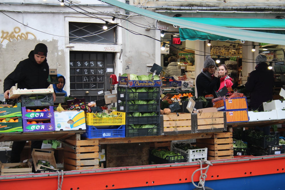Can you spot me browsing the veg shop on this boat in Venice?!