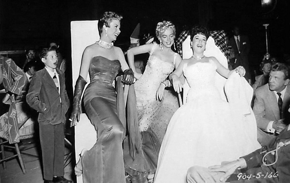 Mitzi-Gaynor-Marilyn-Monroe-Ethel-Merman-and-Dan-Dailey-relax-on-the-set-of-Theres-No-Business-Like-Show-Business-1954.jpg