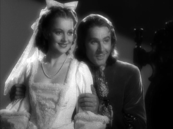 olivia-de-havilland-errol-flynn-in-captain-blood.png