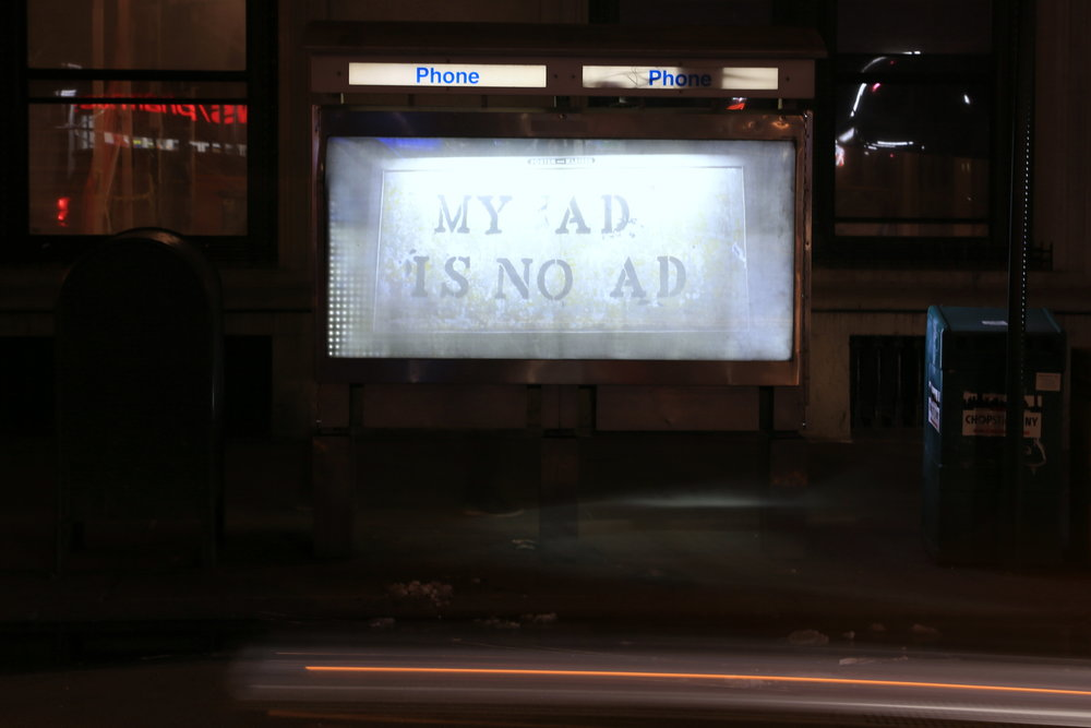 My Ad is No Ad  by John Fekner. Photo by Luna Park. Night shot.