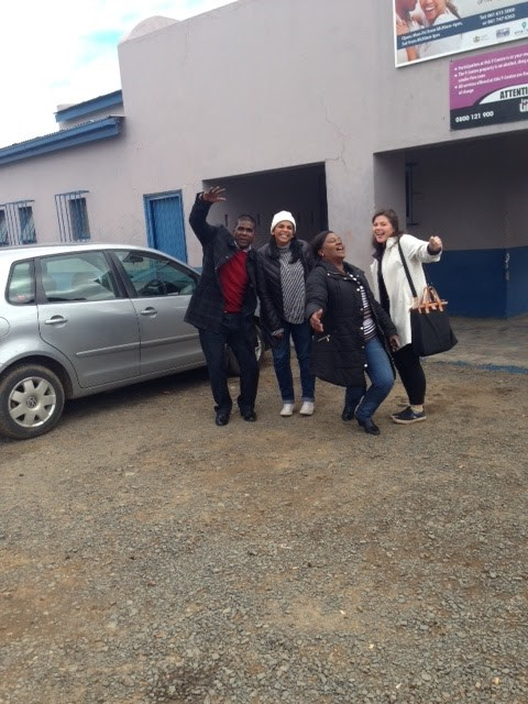 A picture of my team with Mr. G outside the PinPoint/Botshabelo Mobile Clinic