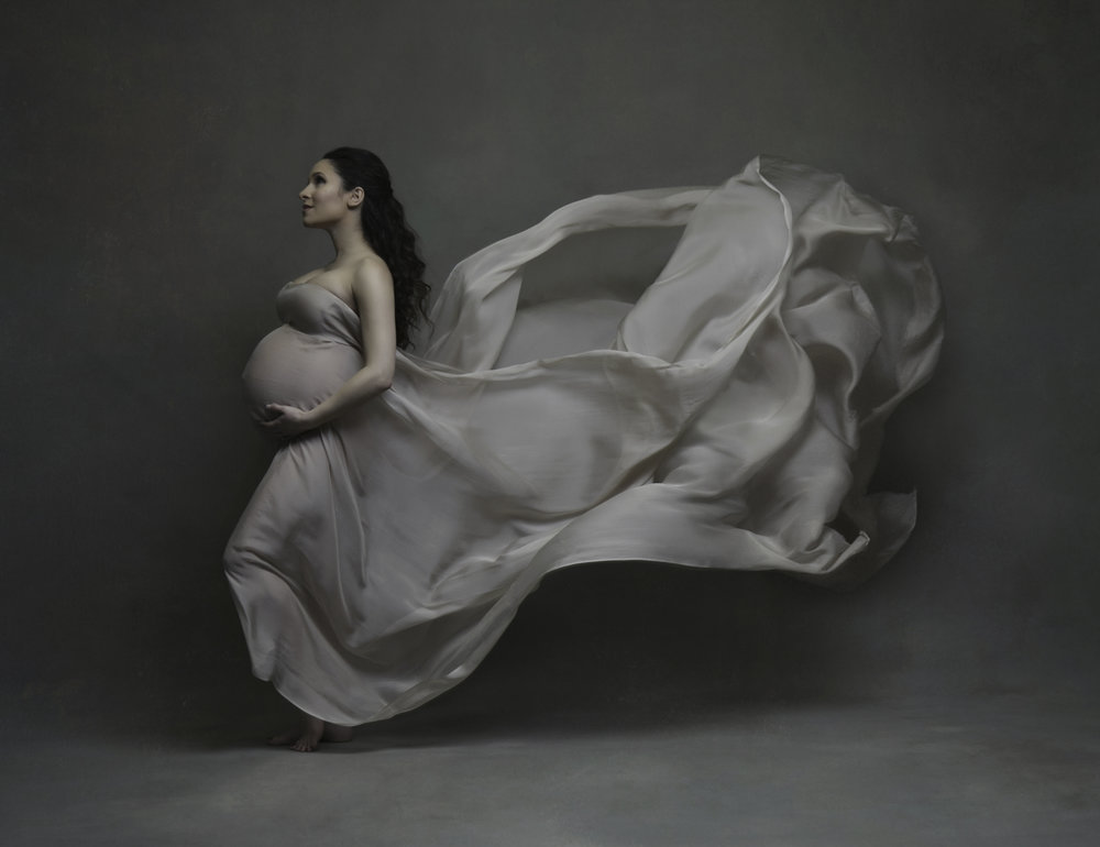 Silk and wind maternity portraits created by Lola Melani at her New York studio