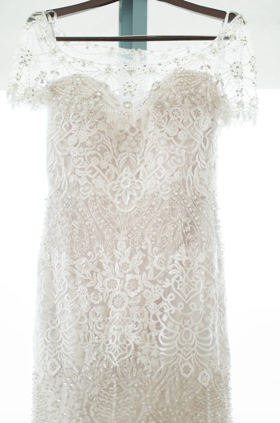 Gown with intricate beads and lace I www.avenueievents.com.png