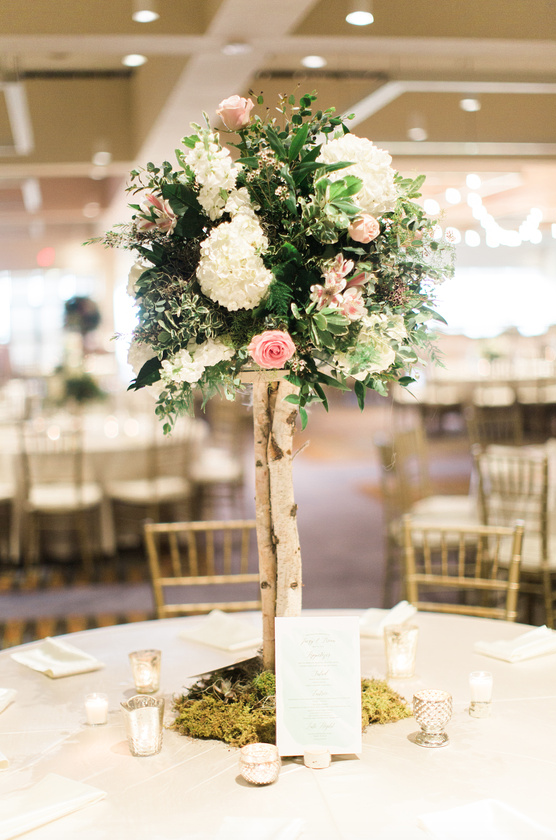 Birch branches base this topiary style arrangement I www.avenueievents.com.png