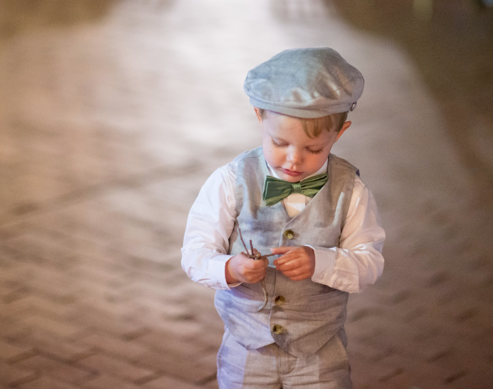Ring bearer in a 3 pc suit I www.avenueievents.com.png