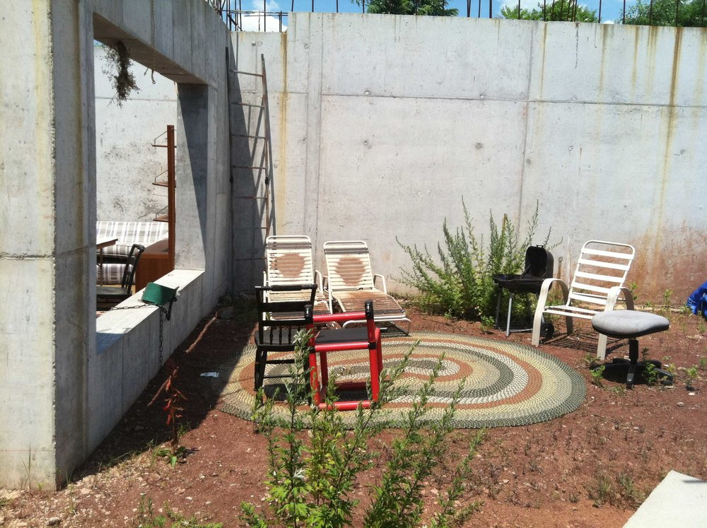 "The outdoor ""Patio"", as it was referred to. Note the escape ladder in the corner, which thankfully never had to be seriously used."