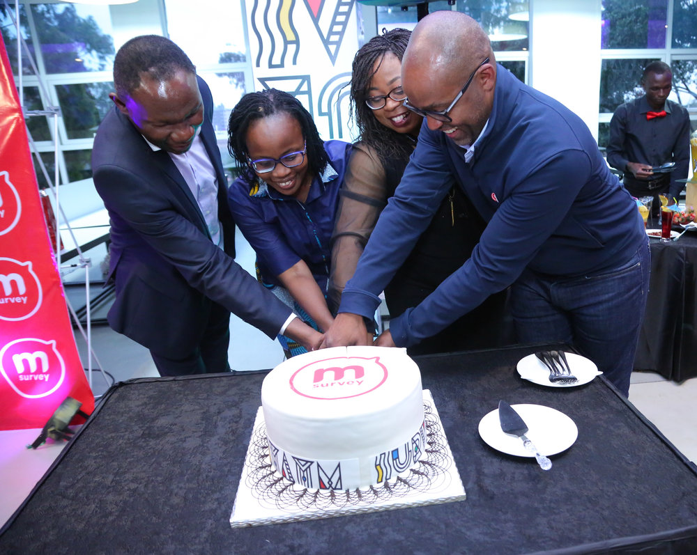 From left to right - Dr. Bitange Ndemo, mSurvey Chief Commercial Officer - Claire Munene, mSurvey Nigeria representative - Laolu Thomas &Dr.Kenfield Griffith (CEO & Co-founder mSurvey) cut cake during mSurvey new office opening.