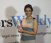 - Rita with the Partner of the Year (Migration) award in 2016.