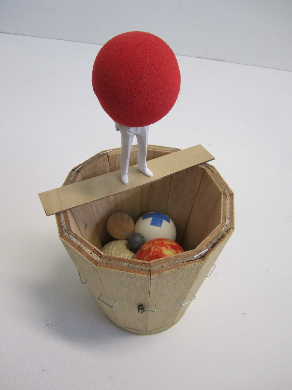 Orrery Storage, 2011    Foam, wood, mouse ball, golf ball, lead ball, rubber ball, table tennis ball, metal staples 24 x 13 x 13 cm