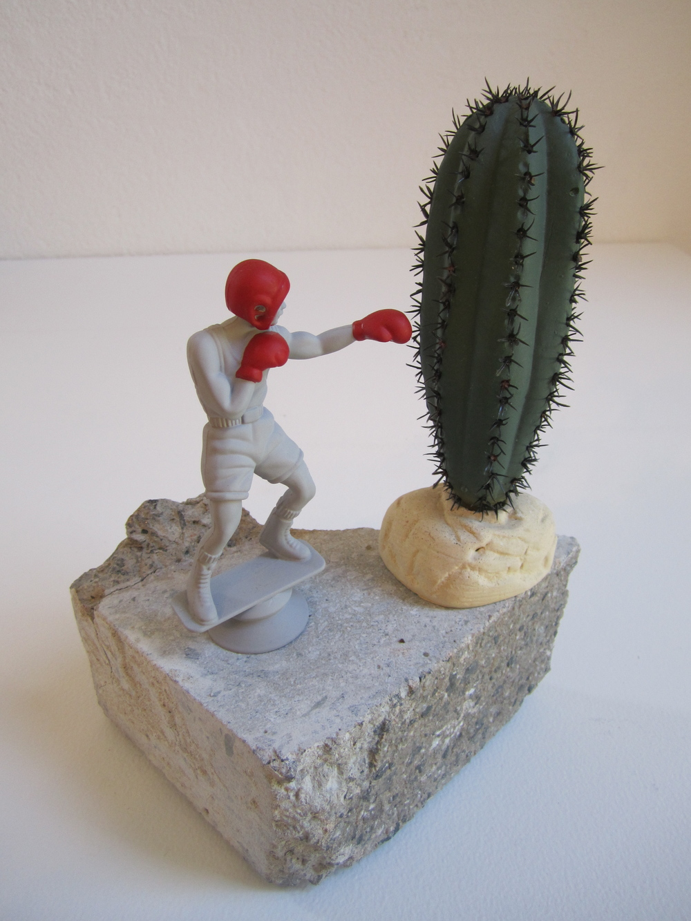 Sharp Jab, 2011    Enamel on acrylic, concrete, plastic 21 x 24 x 14 cm
