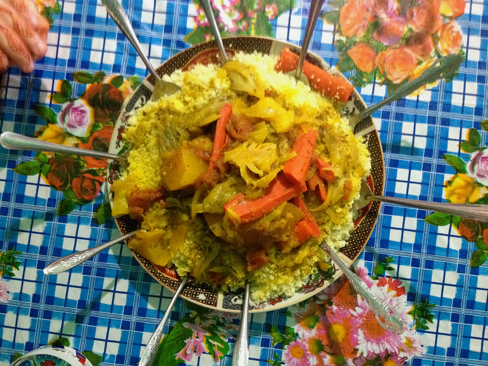 A shared plate of homemade  couscous  in the Moroccan Rif Mountains.