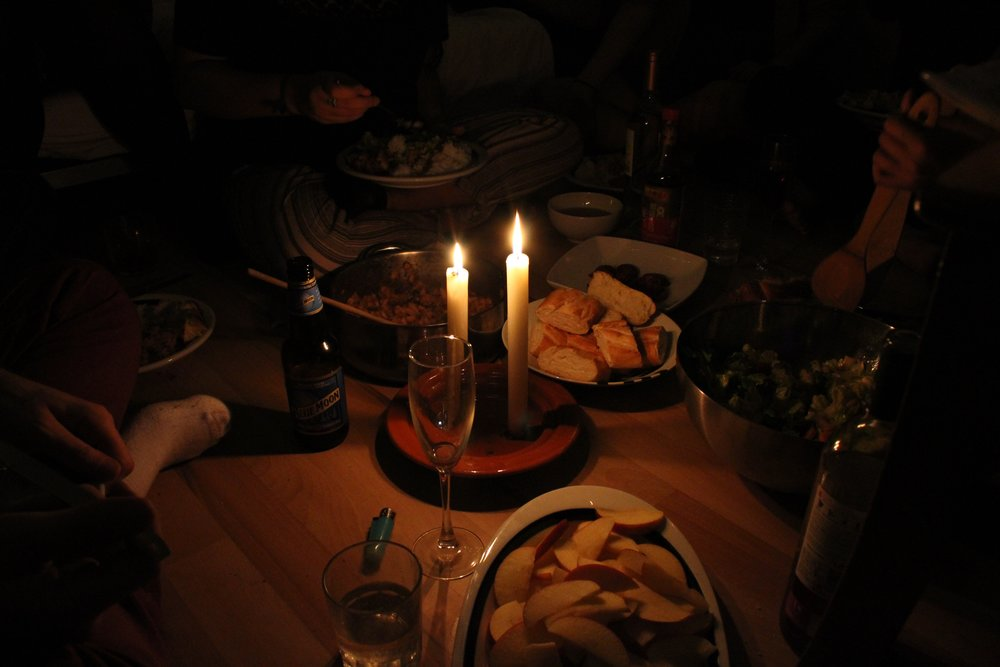 The Rosh Hashanah candles illuminating the meal.