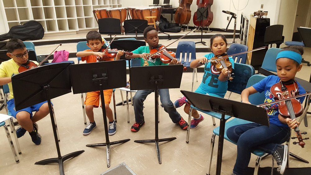 Greater Miami Youth Symphony class using instruments gifted by Share the Music Miami in 2017.