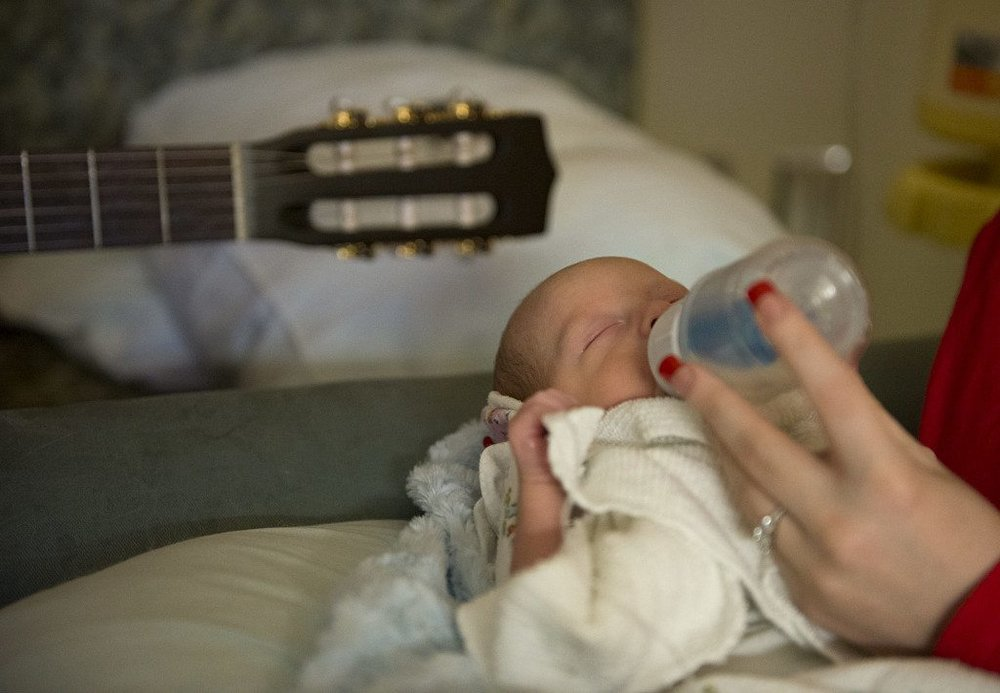 Baby Miles Giese feeds during a music therapy session at PeaceHealth Southest Medical Center.  Photo courtesy of Amanda Cowan/The Columbian.