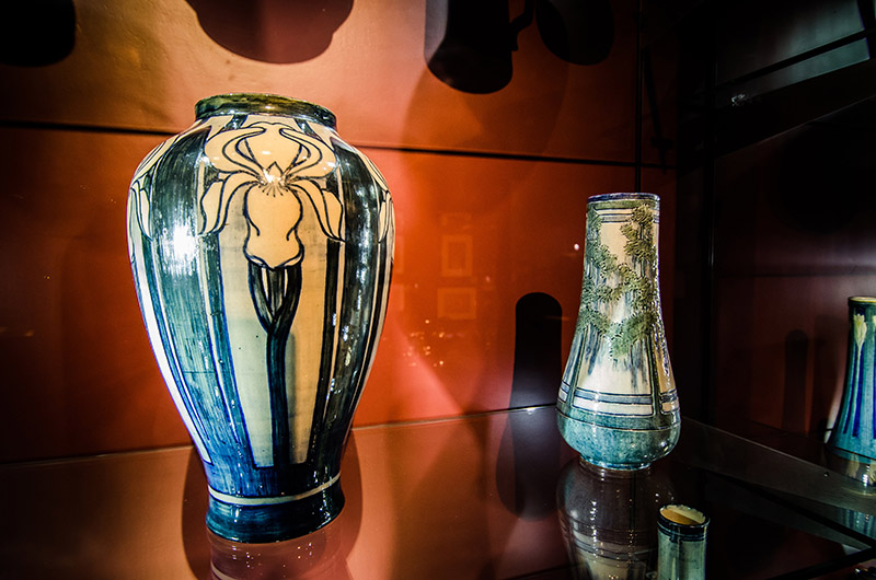 LEFT: Irene Borden Keep (American, b. 1876),  Iris Vase , 1904, high glaze on buff clay pottery, Gift of the Friends of LSU Museum of Art, LSUMOA 84.14