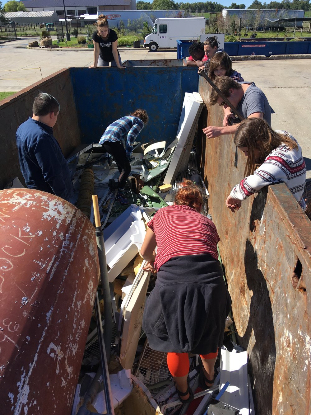 Students finding their materials in the LSU dumpsters.