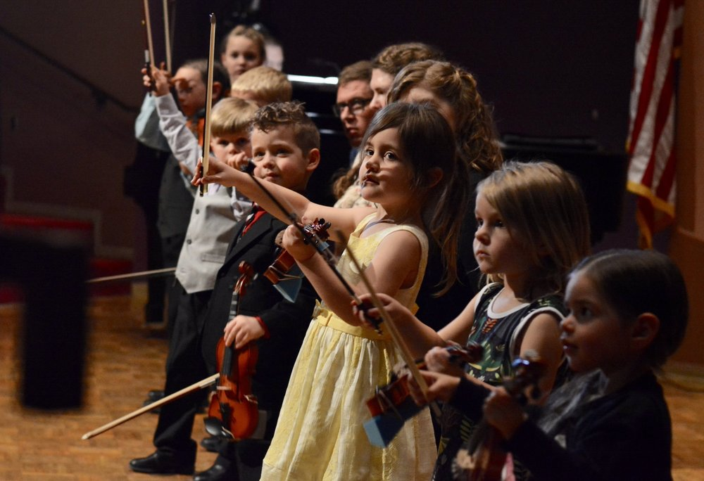 Suzuki violin students in concert. 2018 Photo credit: KaiPing Albright