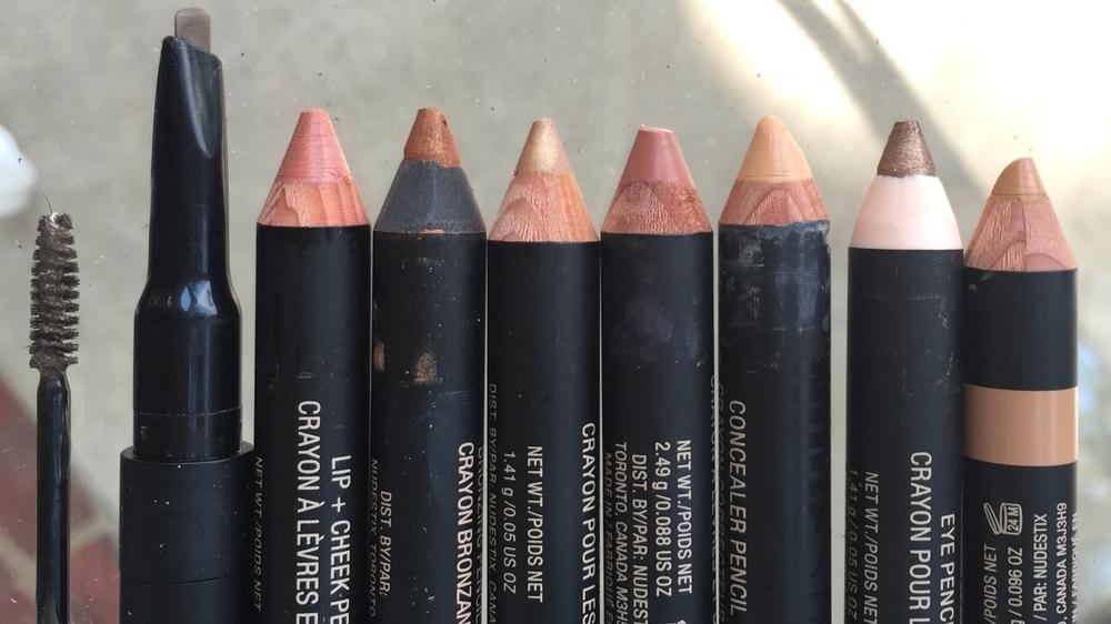 Eyebrow Stylus Pencil & Gel in 'Dirty Blonde', Lip + Cheek in 'Soul', Bronzing Pencil in 'Terra/Brown Sugar', Sheer Eye Color in 'Golden', Lip + Cheek Pencil in 'Blush', Concealer in 'Medium 5', Sheer Eye Color in 'Burnish'. Sculpting Pencil in 'Medium/Deep'.