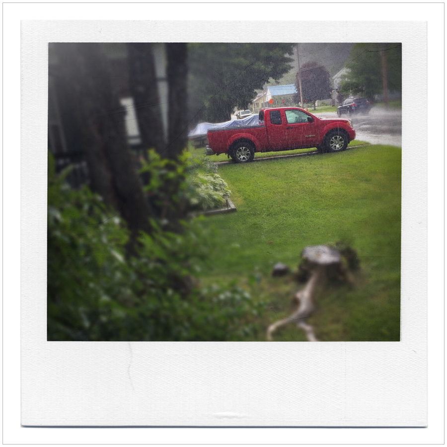 red truck in the rain