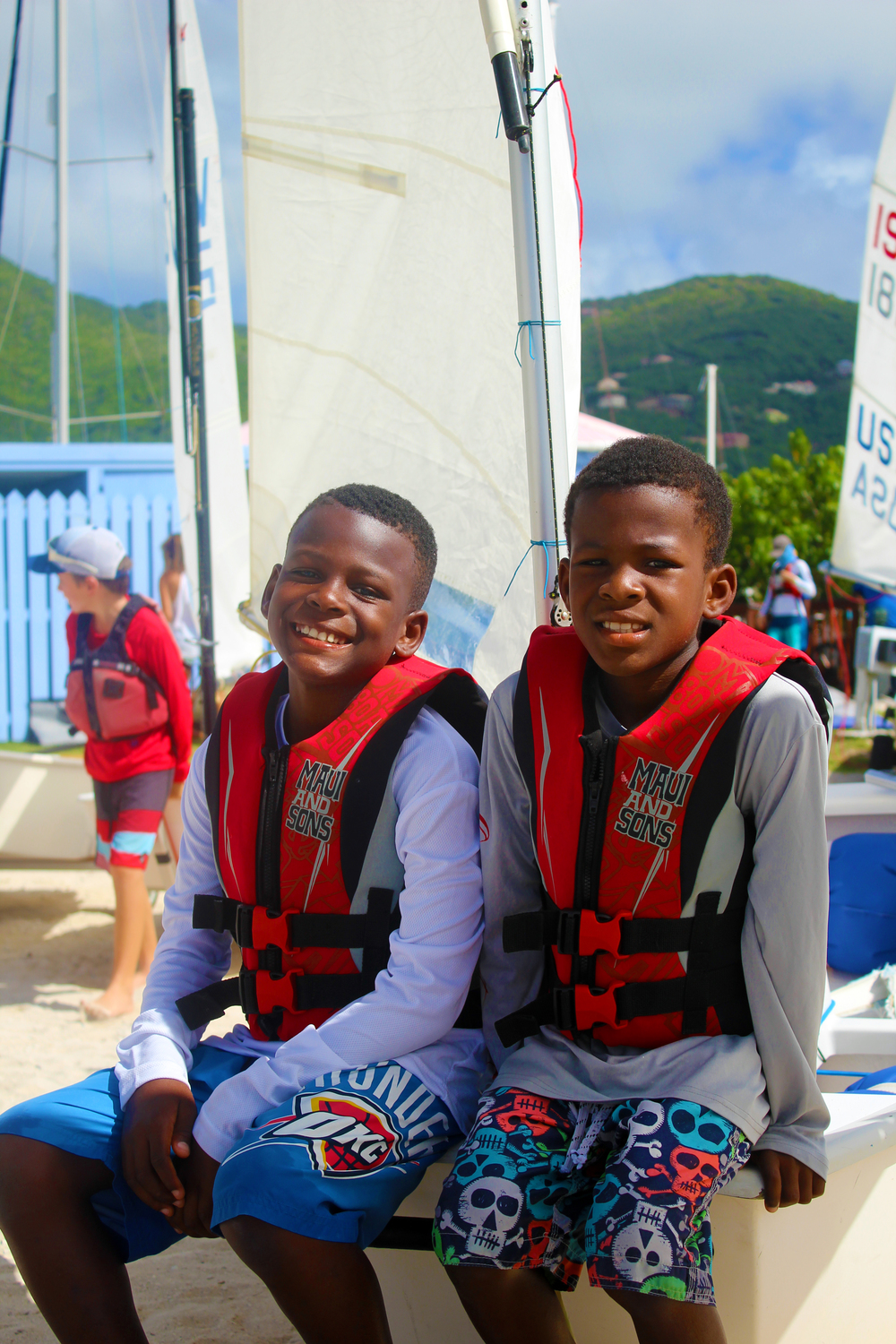 Rodney and Ryan Moorehead compete in Optimist Green fleet.JPG