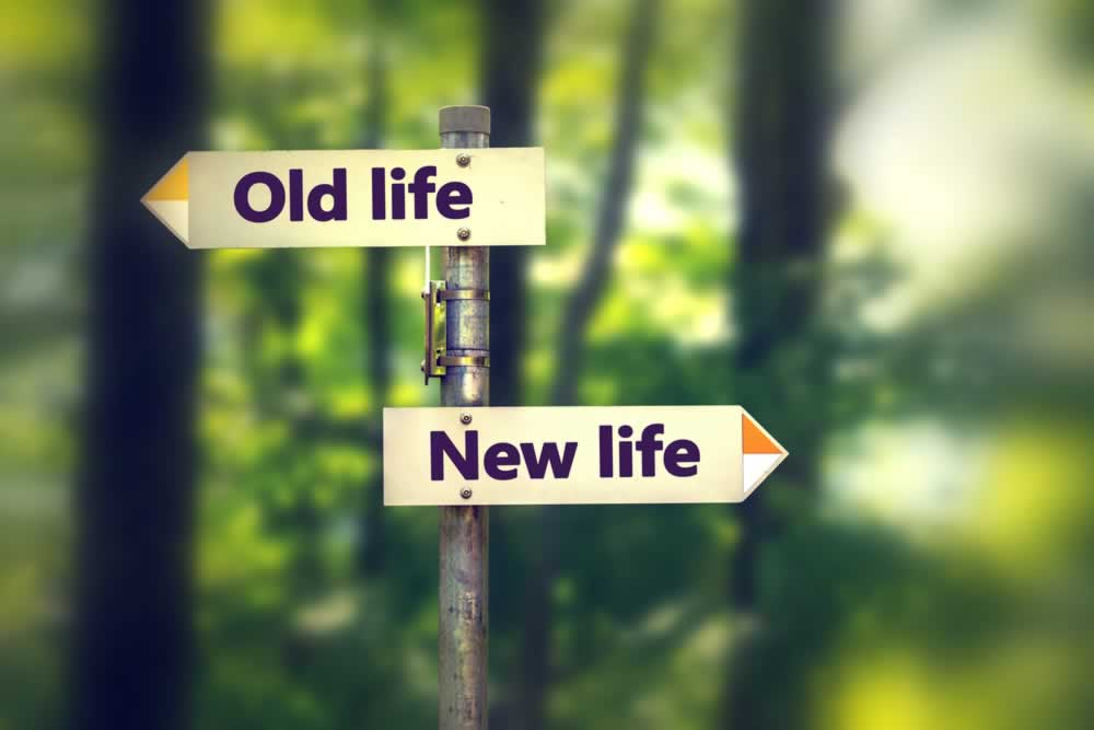"Signs pointing to ""Old Life"" and ""New Life"""