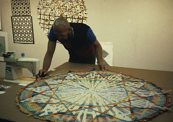 "Alan Shields sewing together ""Equatorial Route,"" from ""The Raggedy Circumnavigation Series"""