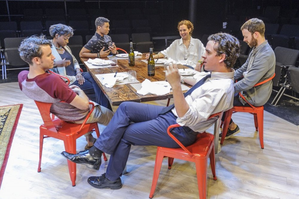 "Clockwise, from foreground head of table: Craig Wesley Divino, Aaron Rossini, Rachel Christopher, Jude Sandy, Claire Karpen, Jimmy King in Act One of ""At the Table."" (Photo by Jacob J. Goldberg)"