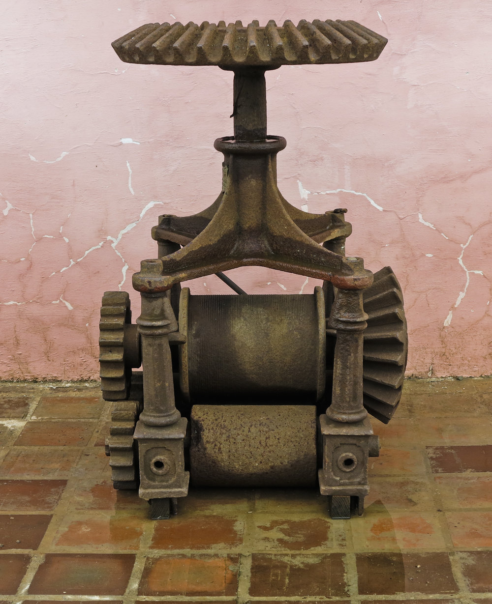 Device used to extract juice from raw sugar cane. Located on a former plantation near Trinidad, Cuba.