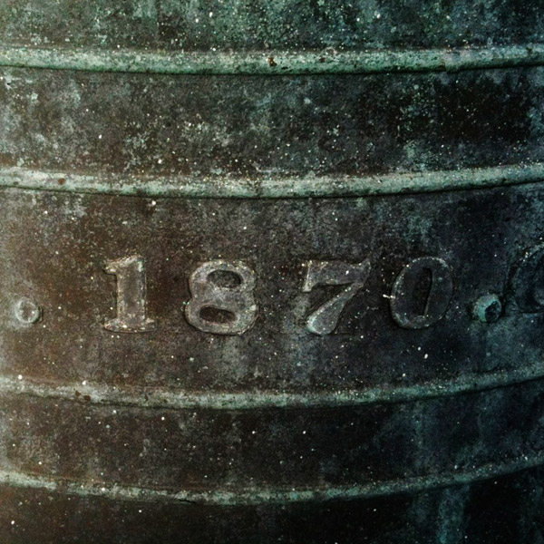 The founding date on the bell in the tower.