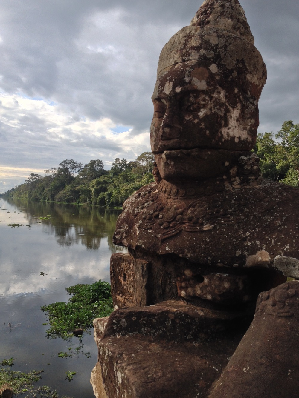 The south gate of Angkor Thom, the capital city of the Khmer rulers, on our way to visit Bayon temple.