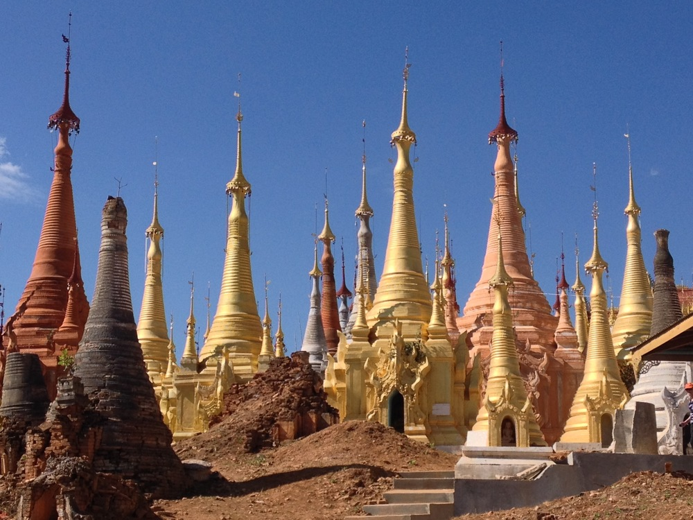 At a remote site located near a Shan tribe village on Inle Lake, 1068 small shrines and stupas surround a pagoda on the top of a hill. The fascinating landscape seems whimsical and reminiscent of an illustration out of a Dr. Seuss book.