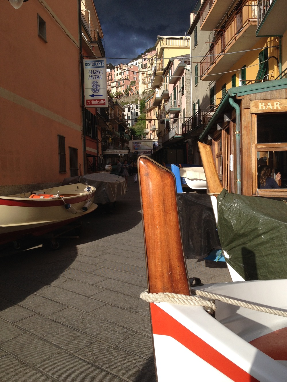 With a storm approaching, the fisherman have hauled their boats up to the pedestrian-only main street in the village of Manarola for safe keeping.
