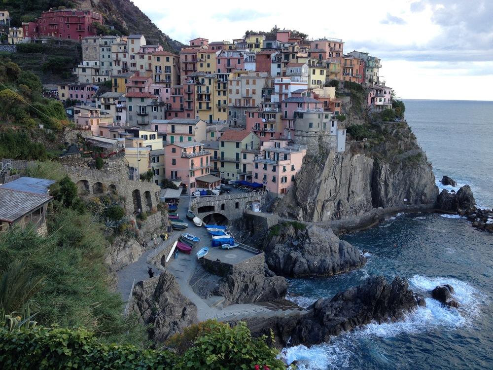 The colorful homes and harbor in the village of Riomaggiore...