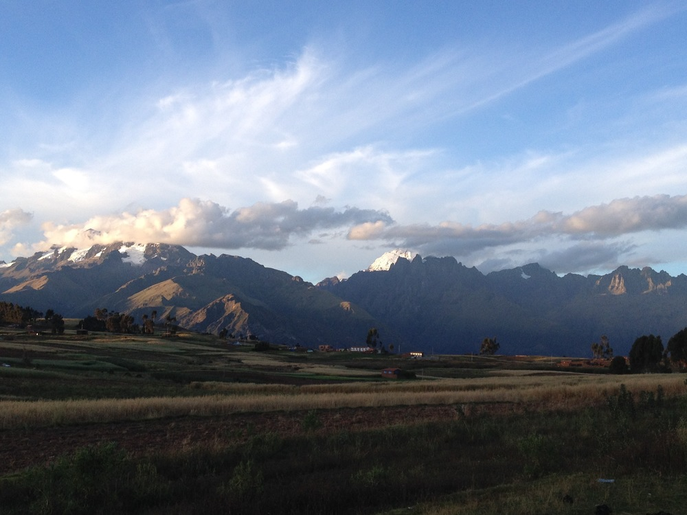 Sun shining through the jagged peaks of the Andes.