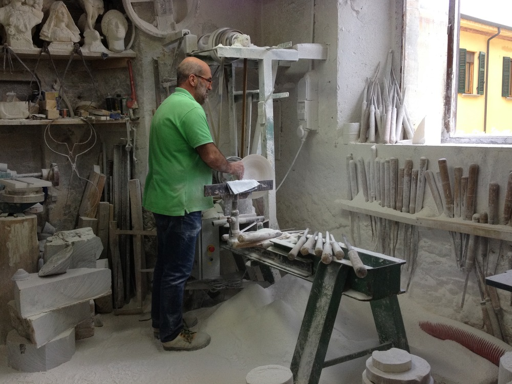 Volterra. An alabaster workshop. Notice the piles of dust below the worker. The interesting thing is that none of them wear masks. Not surprising in a country where Camel sponsors a very crowded smoking room at the airport and, to our dismay, it seems like almost everyone smokes.