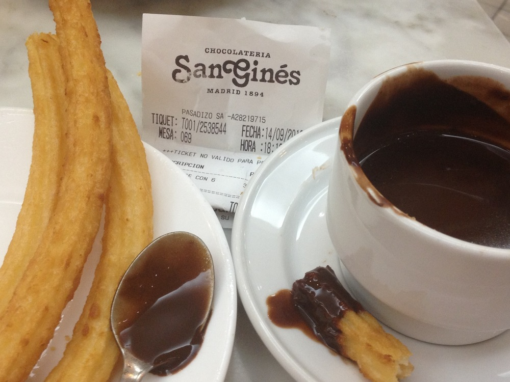 On our last day in Madrid, after foraging through far too many fried foods, fishy sea creatures, pork rinds and offal, we finally found the local landmark bomb: Chocolateria San Gines, home of churros and hot chocolate since 1894! First you dip the churros and then you drink the rest of this hot chocolate that is every bit as rich as a chocolate sauce...completely decadent and delicious :)...tomorrow after stopping at La Rastra, the local Sunday flea market and the largest one in Spain, we head out for Avila with a brief stop in Segovia on the way...