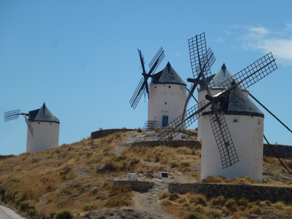 """The highways are a far cry better than the 405 in LA. Endless miles of flawless blacktop stretch as far as the eye can see with only an occasional fellow motorist along the way enabling us to make great time, enough so to include a side trip to the land of La Mancha (Consuegra) with 300 year old windmills, cheese and azafran (saffron). From there, it was on to the Roman ruins in Merida (Temple of Diana below) after an extended tour of a Toledo suburb, courtesy of our GPS navigation system (""""if possible make a U-turn"""" x 30). """"She"""" also can't count worth a damn, especially at traffic circles which are ubiquitous here. Luckily, we also brought some actual maps and a little common sense along."""
