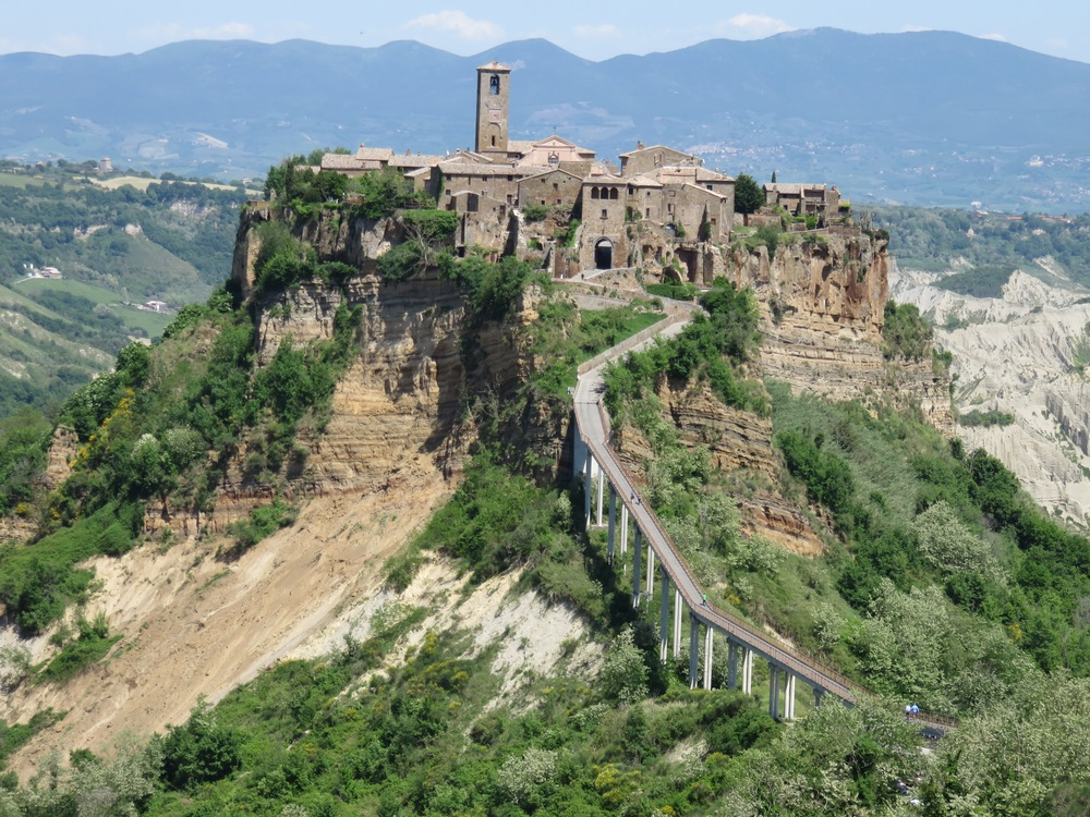 The hill town of Civita di Bagnoregio in Umbria. We have visited many tiny towns in Umbria and Tuscany, this one having just 10 full-time residents now. Another town we visited in Chianti had only a few houses plus a monastery and 3 Michelin restaurants...Go figure.